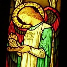 Angelo che reca l'uva simbolo eucaristico